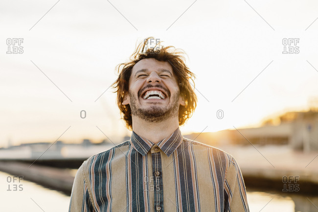 Portrait of laughing at sunset