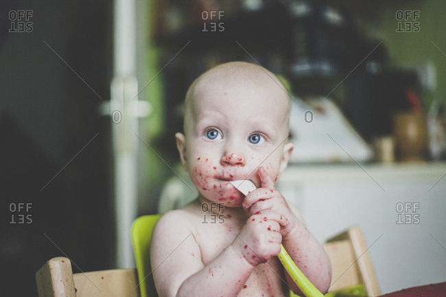 Baby boy making mess while eating