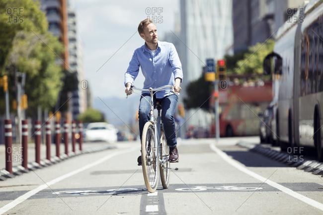 Man with bike on bicycle lane