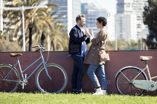 Couple with bikes- face to face