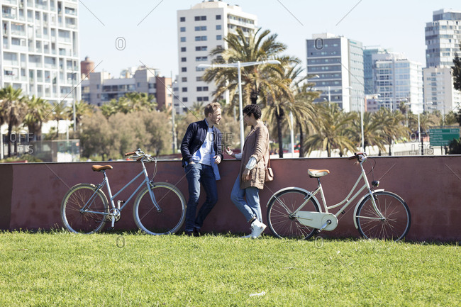 Couple with bikes- talking