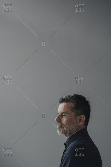 Profile of serious mature businessman