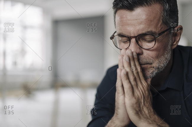 Portrait of mature businessman with closed eyes
