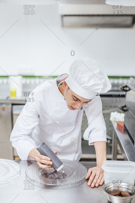 Junior chef preparing a dessert plate