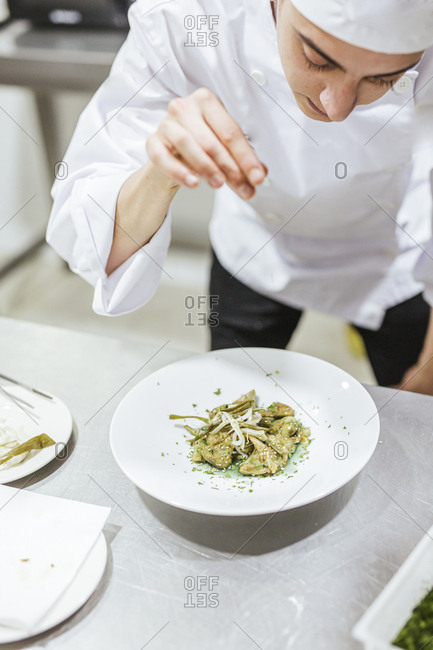 Junior chef preparing a dessert on plate