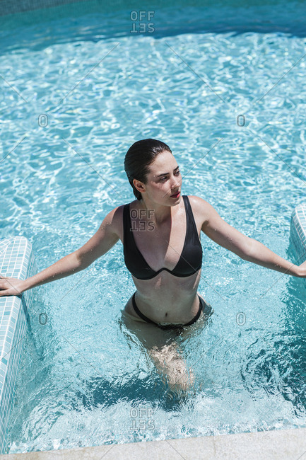 Young woman enjoying the summer time at pool
