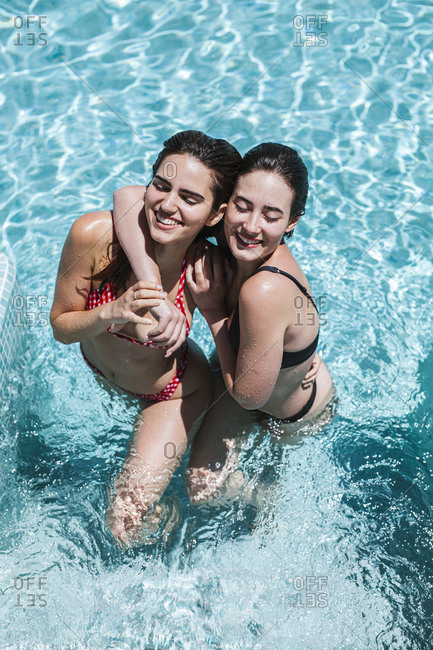 Young women enjoying the summer time at pool
