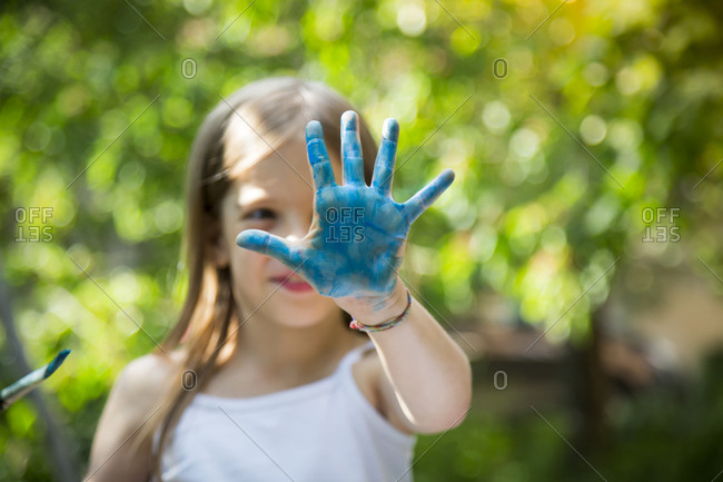 Girl's blue painted hand