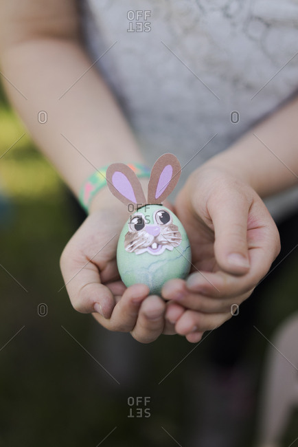 Close-up of girl holding decorated Easter egg