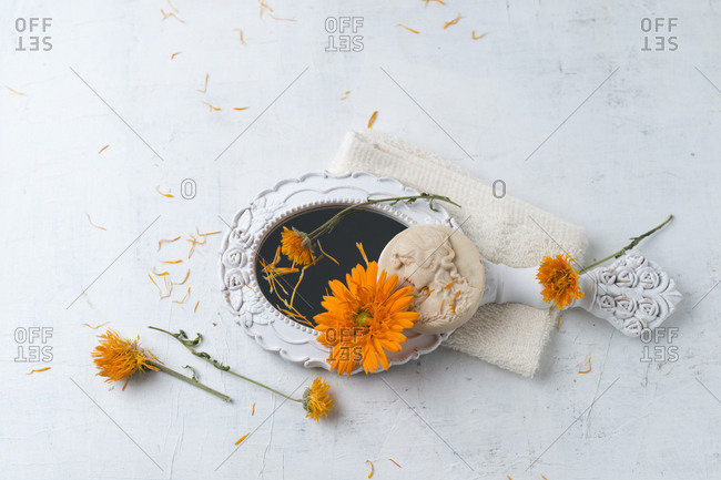 Marigold soap- hand mirror and flower heads