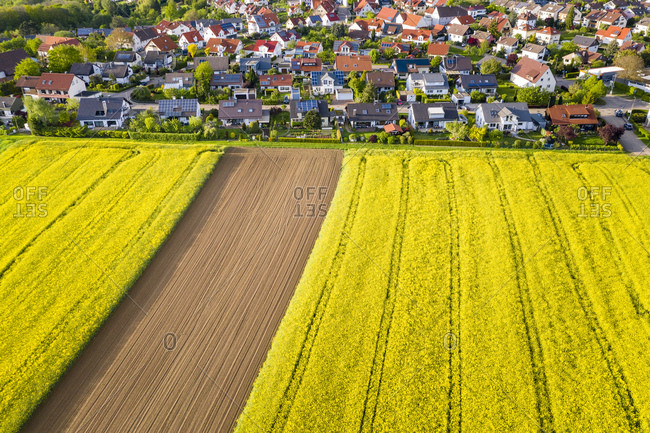 Aerial view over rape fields and houses near Schlichten- Swabian Franconian forest- Germany