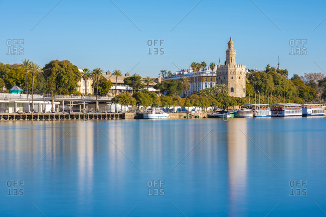 January 26, 2019: Long exposure of Guadalquivir River from Triana with the Torre del Oro- Seville- Spain