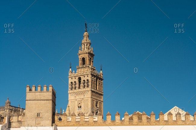 The Royal Alcazar and la Giralda tower minaret- Seville- Spain