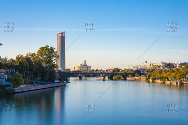 January 26, 2019: Long exposure of Torre Sevilla and bridge crossing the Canal de Alfonso XIII- Seville- Spain