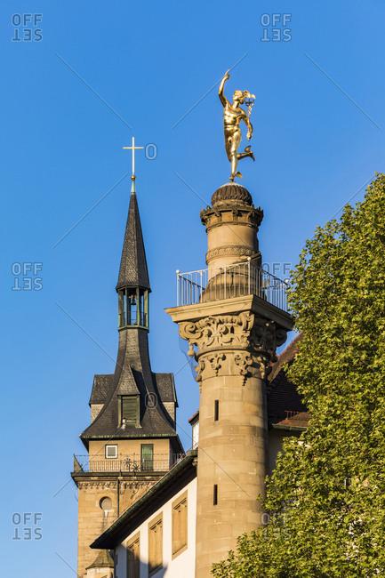 Collegiate church and Merkursaeule with golden mercury on top- Stuttgart- Germany