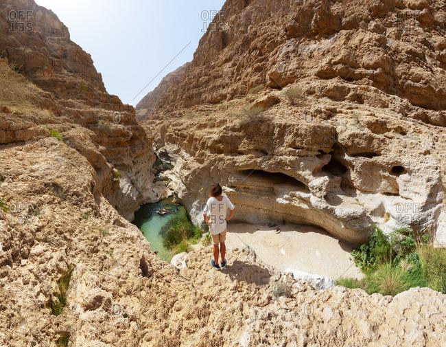Man enjoying the view over Wadi Shab- Oman