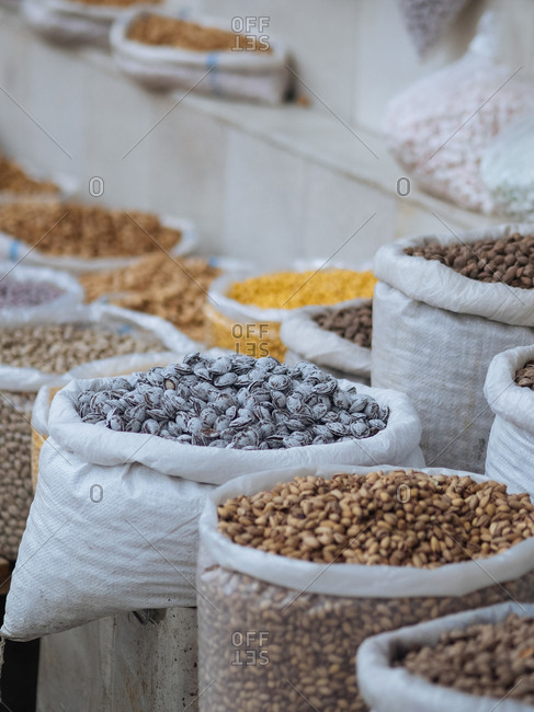 Variety of nuts and legumes in sacks for sale in market in Uzbekistan
