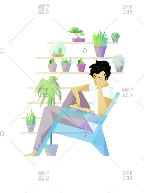 Man reading surrounded by plants