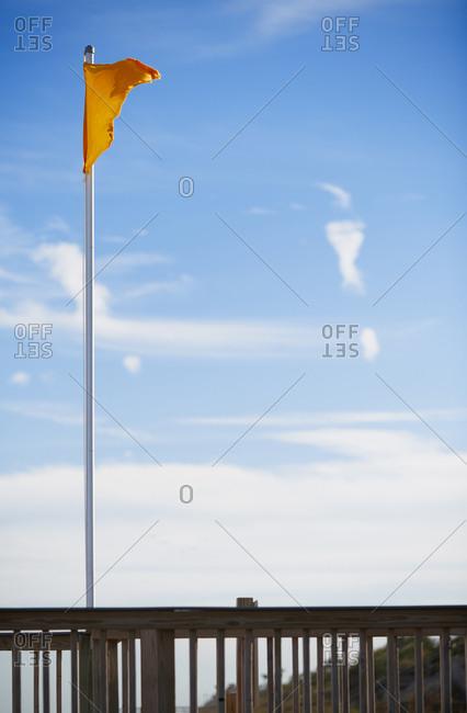Yellow hazard flag at the beach lifeguard platform