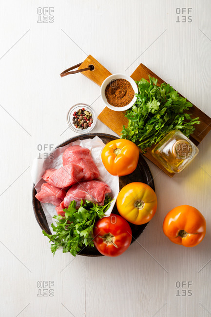 Raw beef meat and fresh vegetables