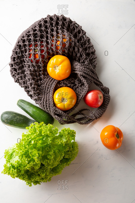String shopping bag with vegetables, green living concept