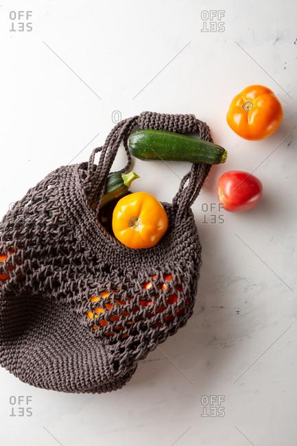 Eco friendly shopping bag with fresh veggies