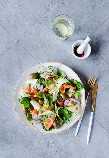 Smoked salmon salad with mustard dressing top view