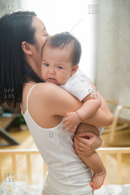 indian mother and child at home stock photos - OFFSET