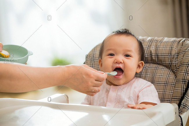 Mother to feed the baby rice