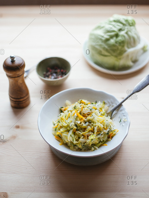 Cabbage stewed with carrot, white onion and dill