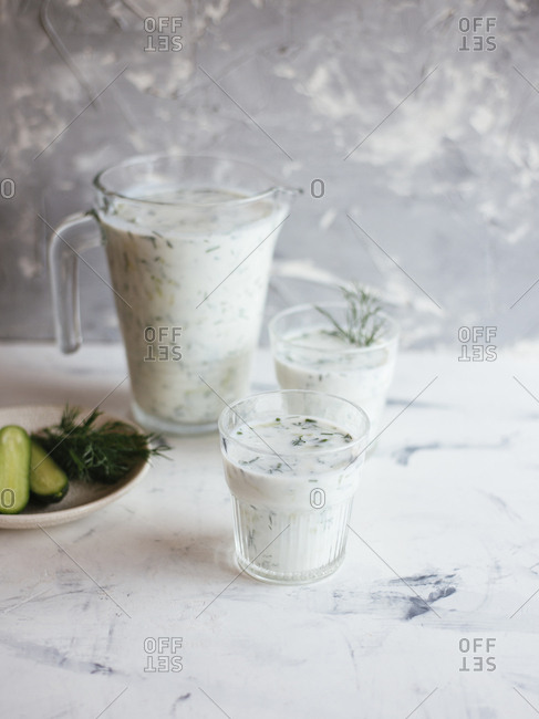 Homemade yogurt drink Ayran with fresh dill and cucumber