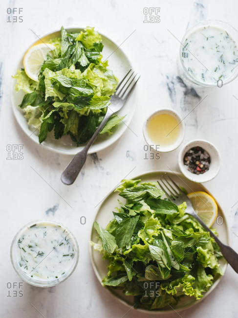 Cucumbers with herbs and lemon dressing served with sour yogurt drink