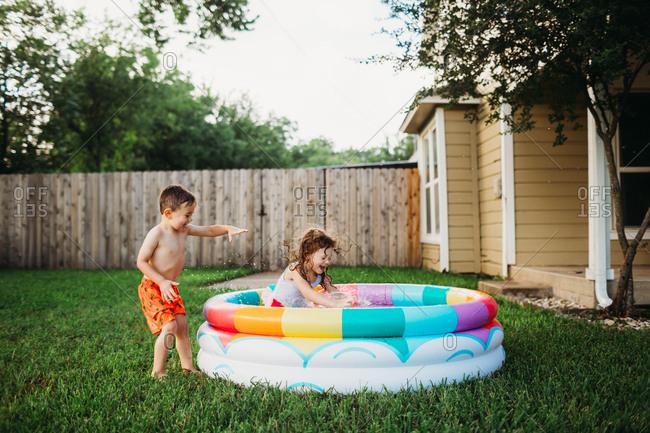 Kids splashing in colorful inflatable pool