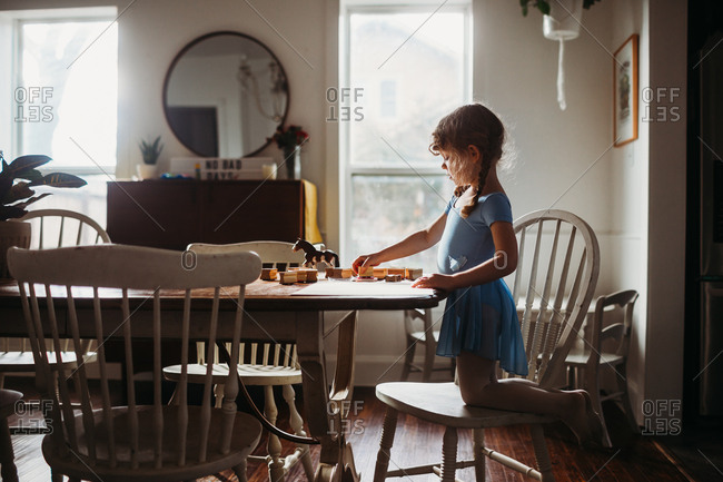 Little girl making artwork with stamps