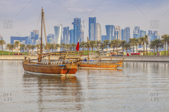 January 3, 2016: Boats by skyscraper skyline in Doha, Qatar
