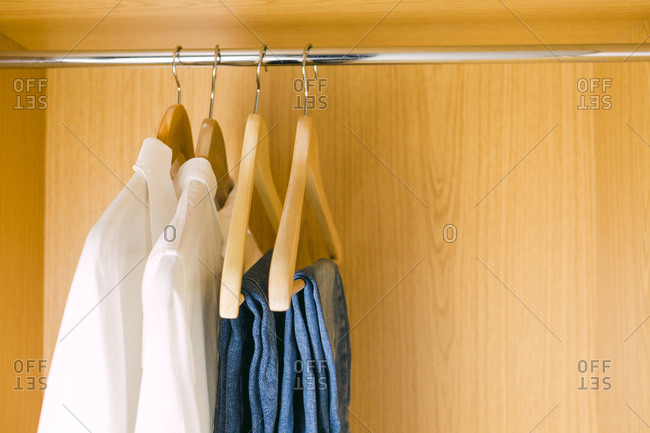 Clothes hanging in wardrobe