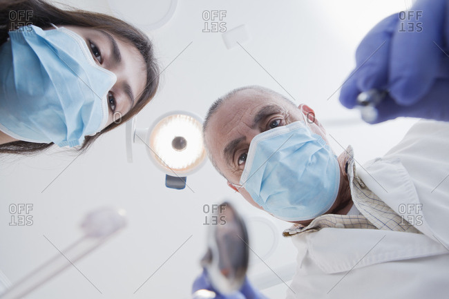 View directly below dental hygienist and dentist during examination