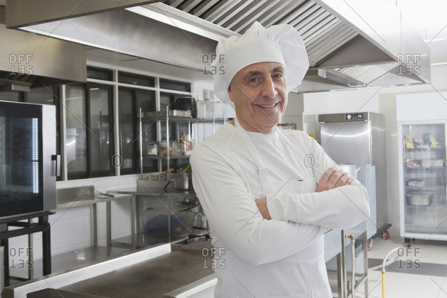 Chef smiling in commercial kitchen