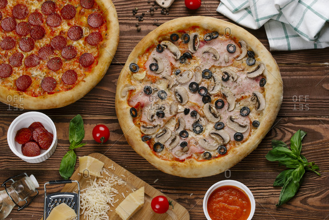 Pepperoni and mushroom pizzas with ingredients