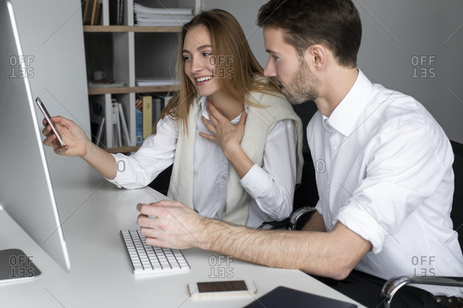 Businesspeople using computer together