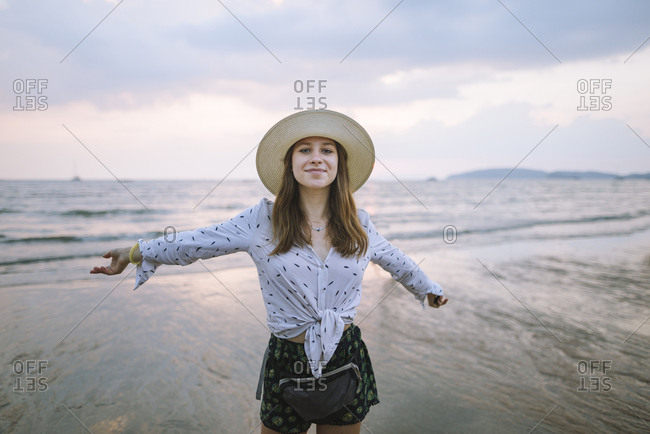 Young woman in sun hat on beach in Krabi, Thailand
