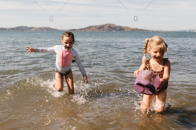 Little girls playing in the ocean