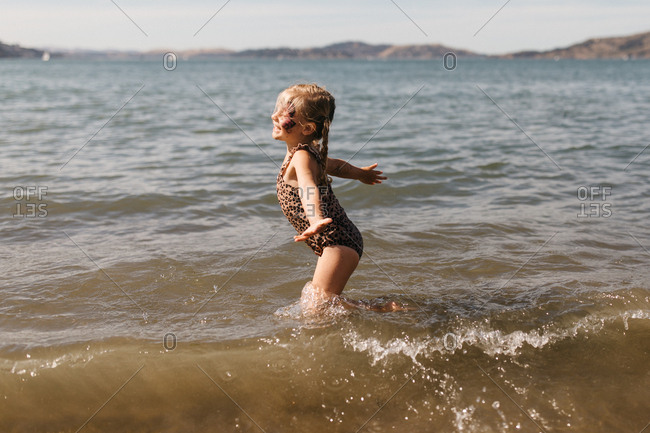 Little girl playing in the ocean