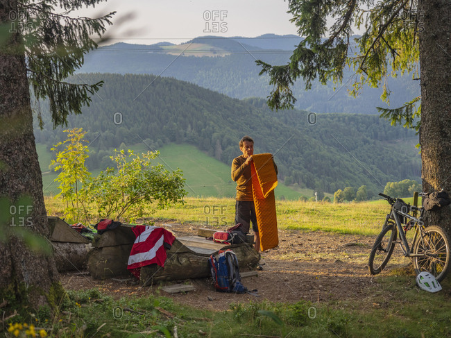 Mountain biker resting in the forest, Baden-W�rttemberg, Germany