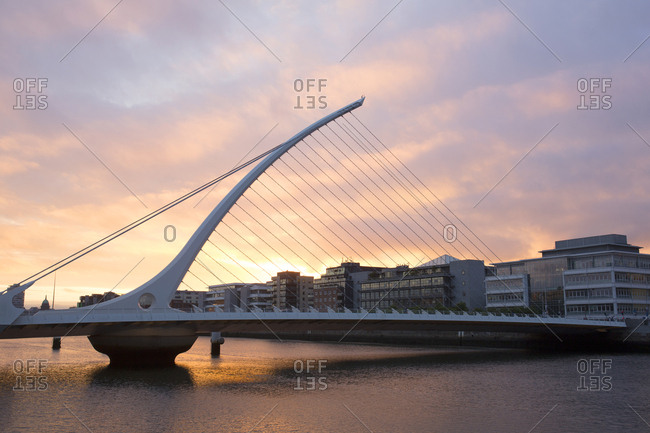 Dublin, Ireland - May 25, 2019: Samuel Beckett bridge river Liffey at sunset