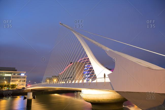 Dublin, Ireland - May 25, 2019: Samuel Beckett bridge river Liffey at dusk