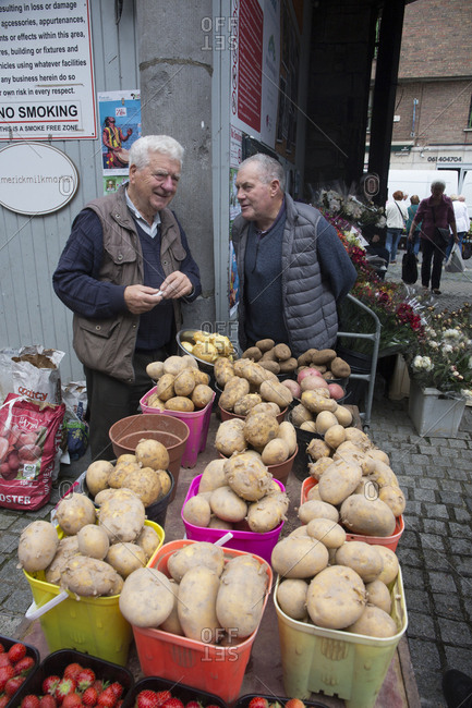 Limerick, Ireland - June 1, 2019: Milk market day and men with potatoes for sale
