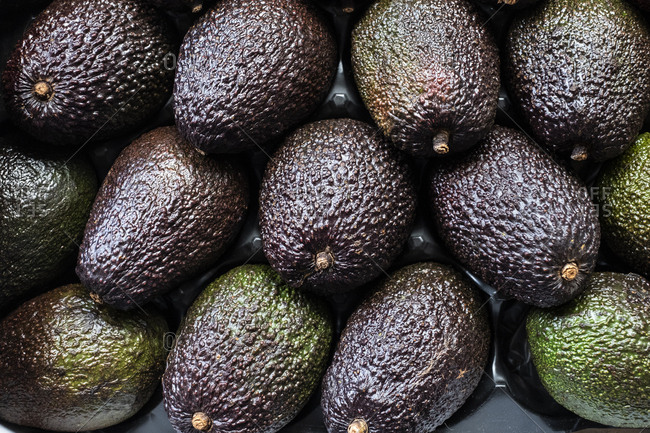 Full frame close up of fresh avocados.