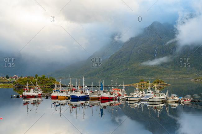 July 17, 2019: Fishing boats and traditional wooden huts, Lofoten islands