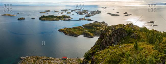 Henningsvaer on Lofoten islands with sheltered harbour and bridges connecting rocky islands